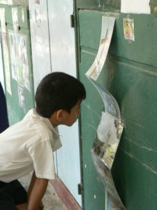 Fig. 14: Student viewing exhibition in school. Source: Arts-ED