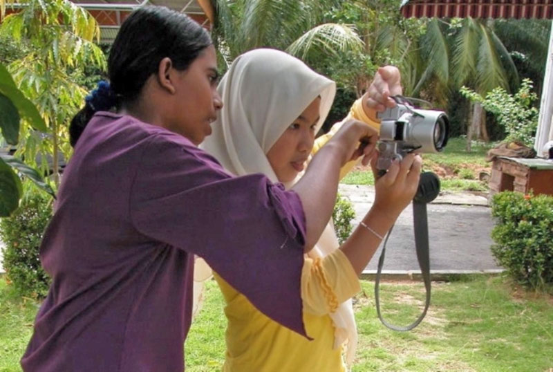 Participants learning photography skill through photography workshop. Source: Arts-ED