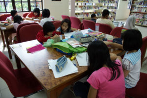 Fig. 2: Children creating their posters. Source: Arts-ED