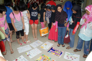 Fig. 3: Children peer-judging the work created for the poster competition. Source: Arts-ED