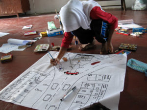 Fig. 6 Participant drawing a map of Balik Pulau town. Source: Arts-ED
