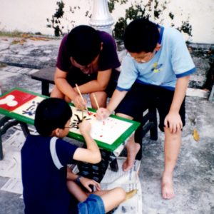 Students from finishing a signboard (2001)